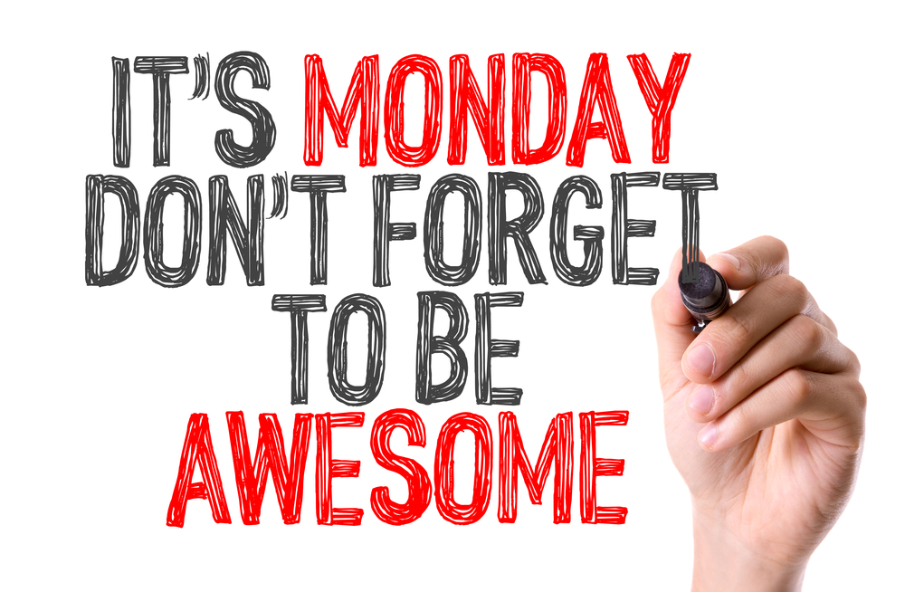 Hand with marker writing Its Monday Dont Forget to be Awesome